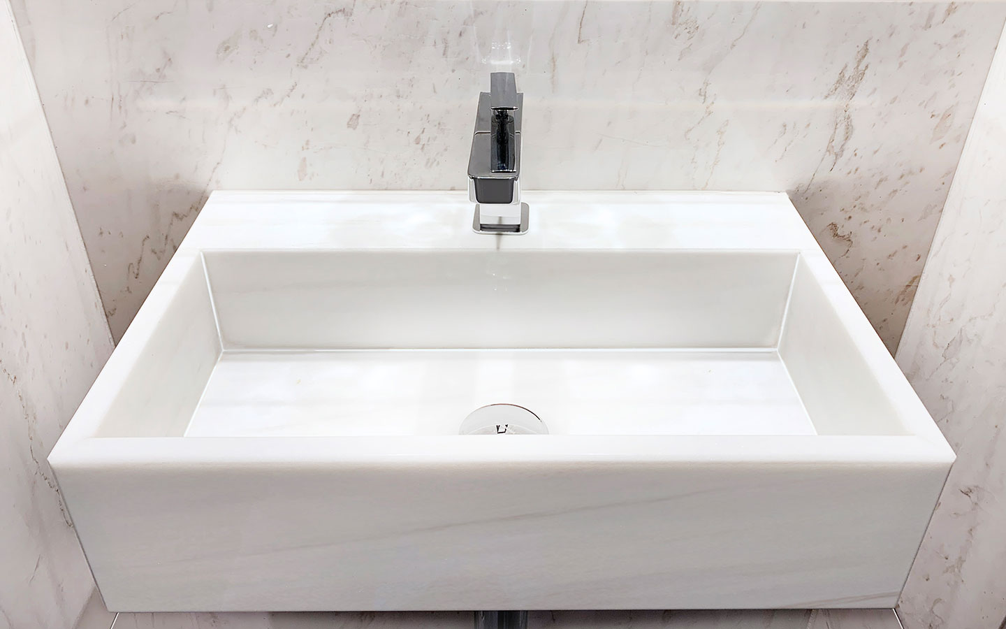 Custom-made white marble sink, supplied and installed by M&G Ltd – Private residential