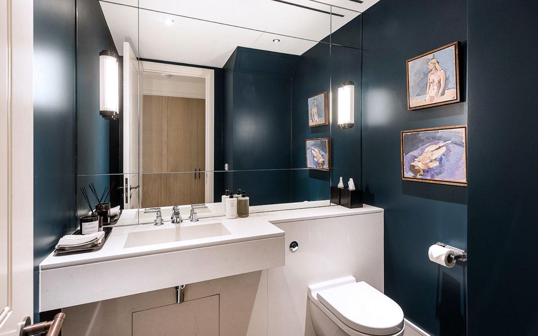 Bespoke quartz stone wash basin and cladding in a guest WC