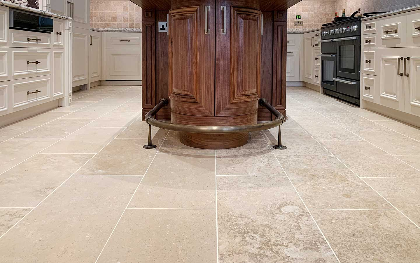Honed French limestone floor tiles in a traditional kitchen
