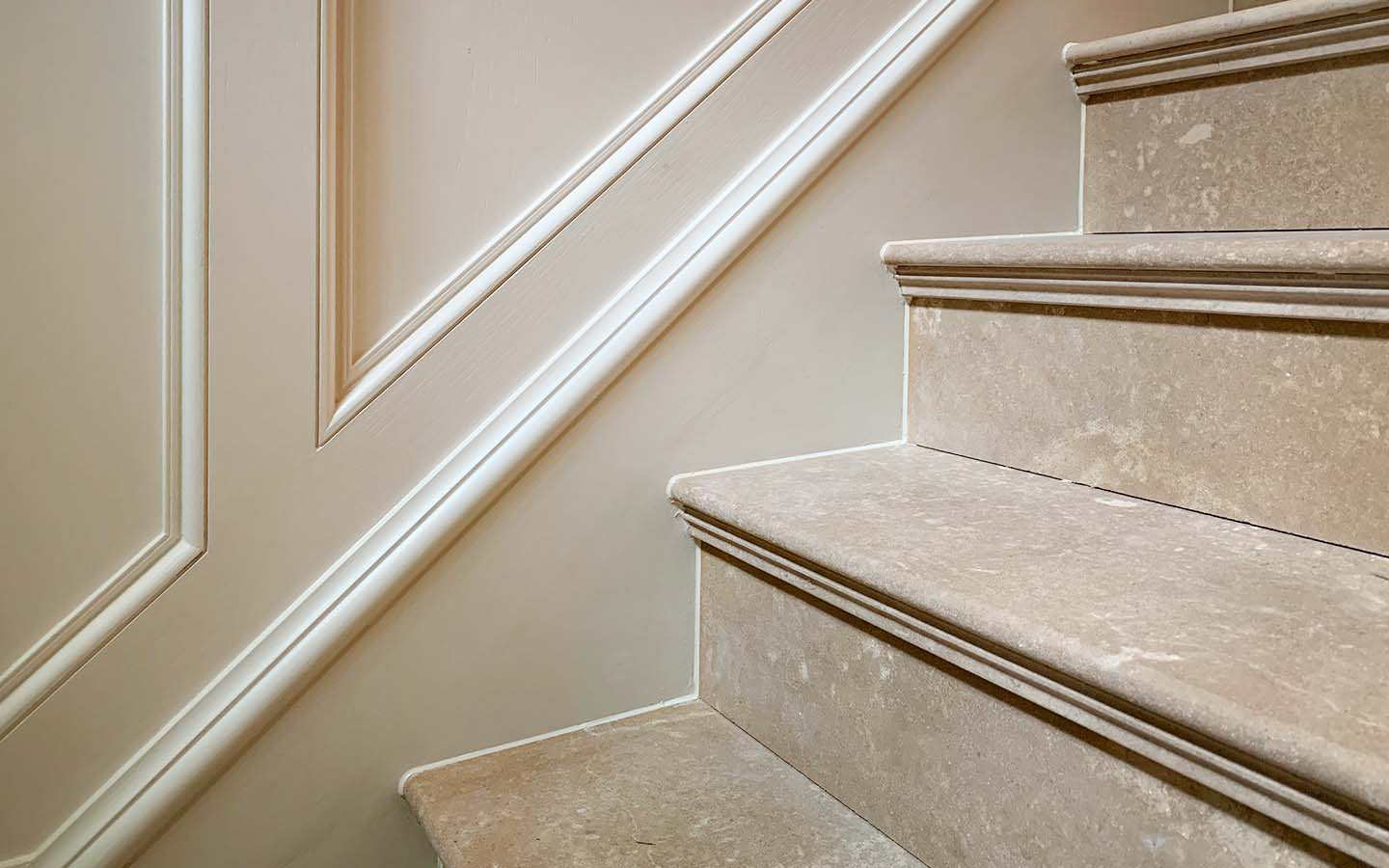 Honed limestone stair treads with profiled nose, supplied and installed by M&G Ltd - Private residential