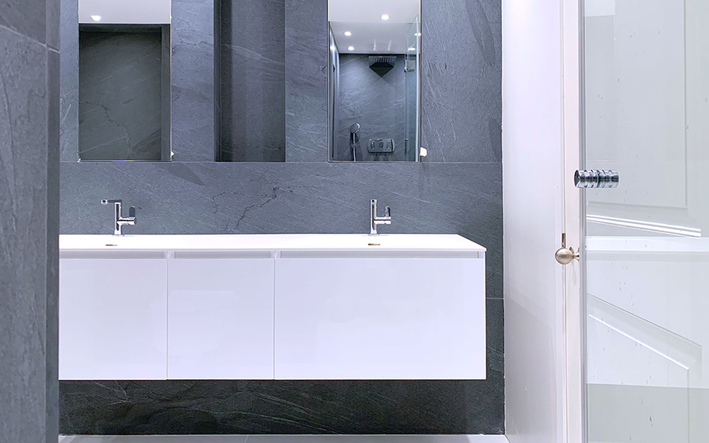 Pietra Cardosa grey sandstone clad bathroom, supplied and installed by M&G Ltd - Private residential