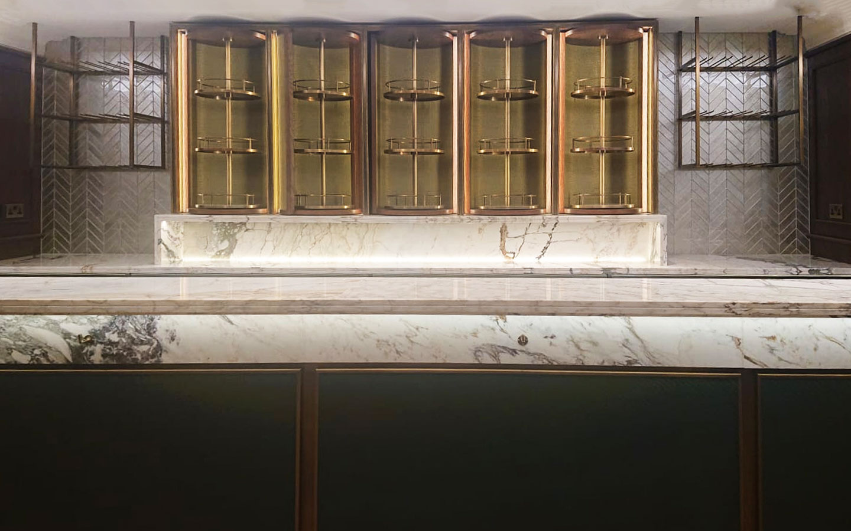 The Rib Room - TCJH - Breccia Capraia marble bar tops