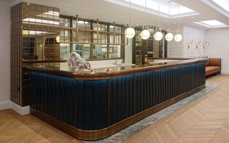 The Rib Room - TCJH - Bespoke glazed lavastone tiles + mirror tiles + white quartz bartops